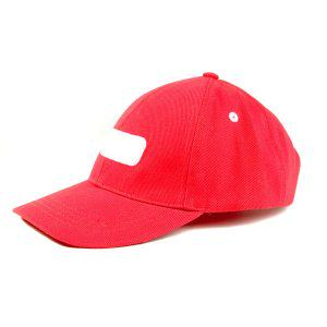 Red baseball hat close up on white ground